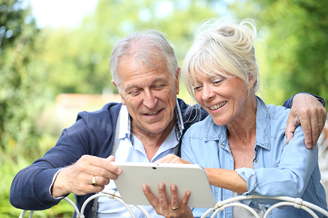 Senior couple using a tablet to browse the internet