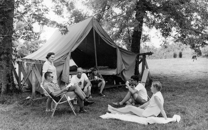 Vintage photo of a family on a camping holiday.