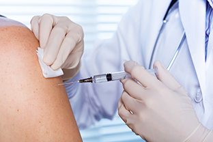 Doctor providing a vaccination for flu.
