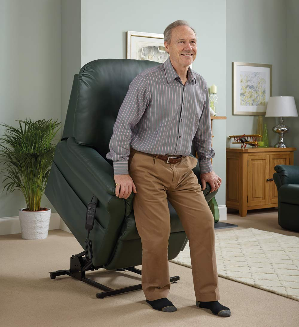 Elderly man rising out of a rise and recline chair.