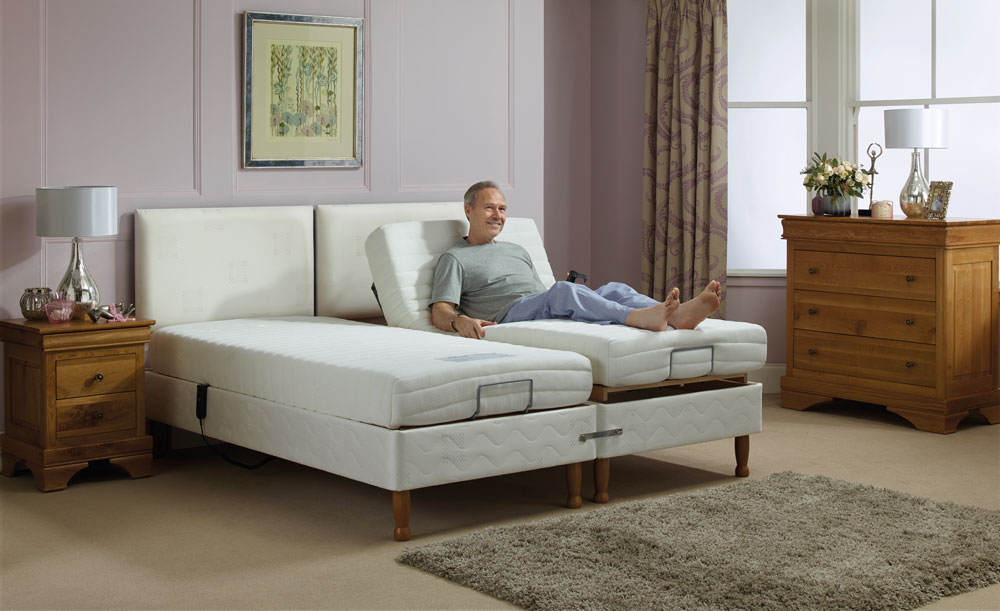 Man enjoying an adjustable bed