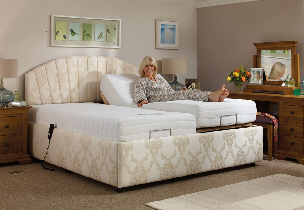 Woman enjoying her Oak Tree Mobility double adjustable bed