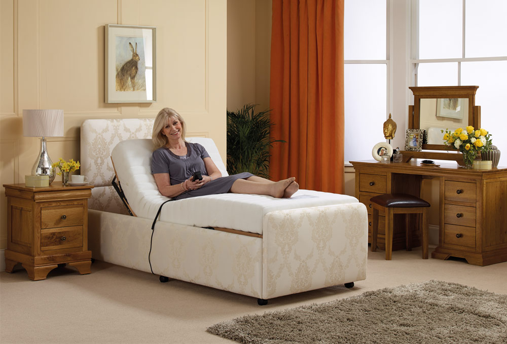 Lady resting in a single adjustable bed