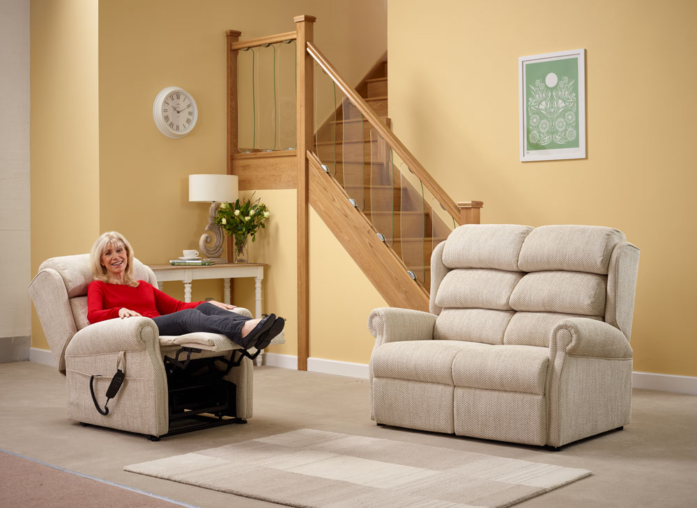 An elderly lady relaxing in a rise and recline chair
