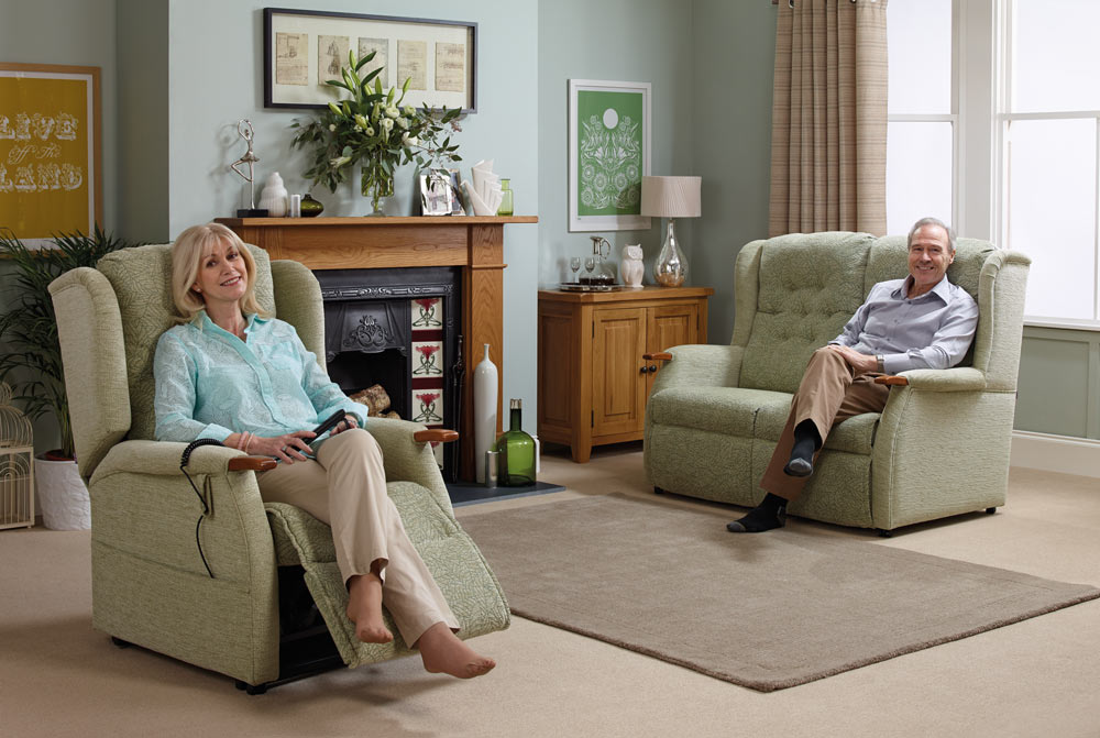 Elderly couple enjoying their rise and recline chair and sofa set