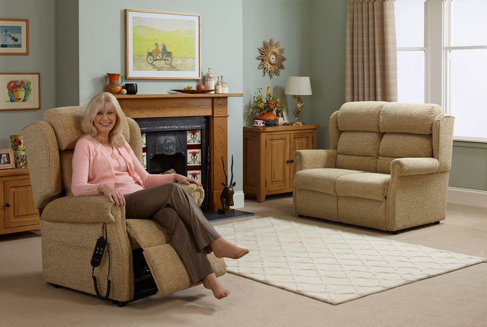 Elderly woman enjoying her rise and recline chair in her living room