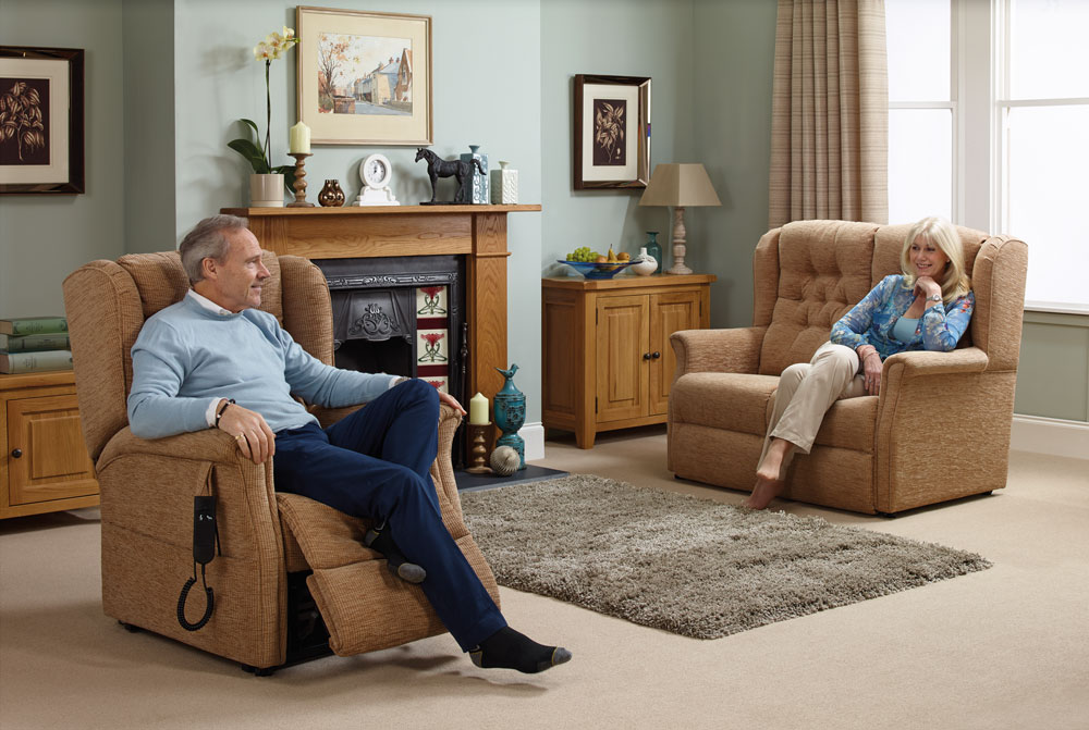Elderly couple enjoying oak tree rise and recline chairs